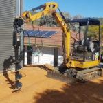 machinery shovelling spade